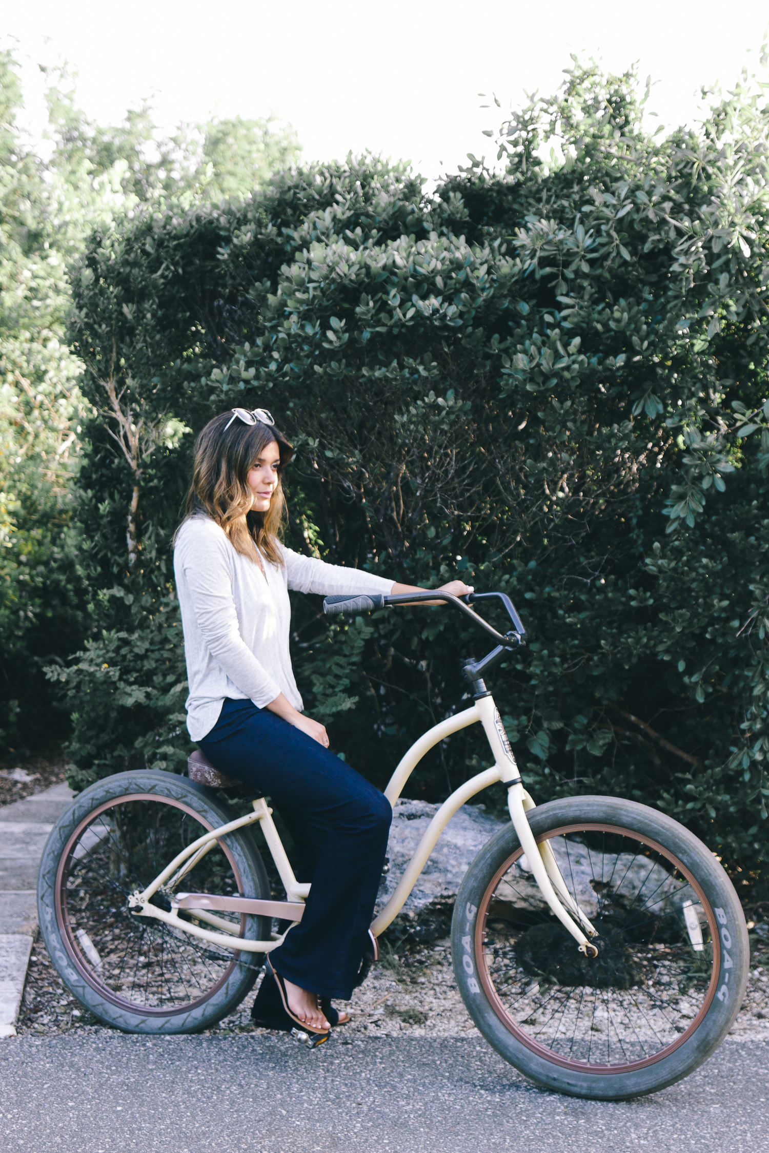 Guess outfit on a bike