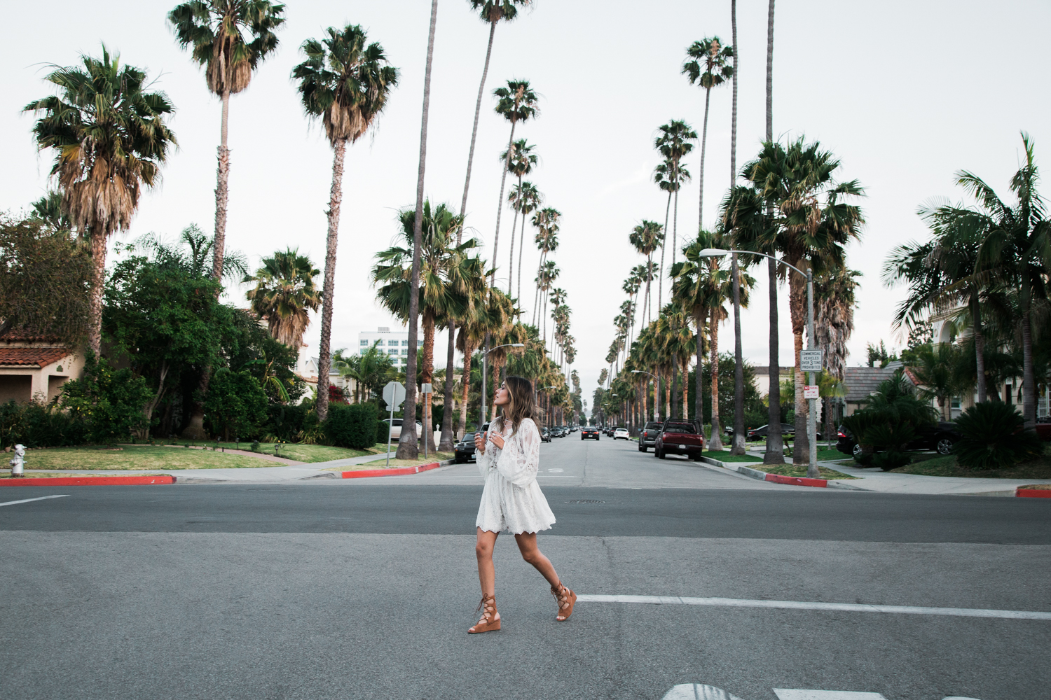 Sara Azani of Style MBA wears a white Zimmermann lace dress