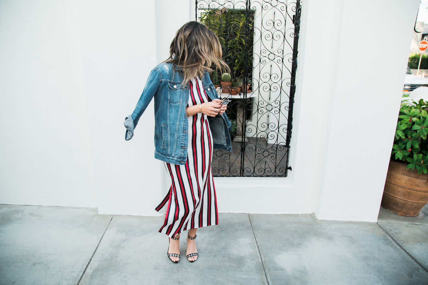 Sara Azani of Style MBA wearing Finders Keepers striped dress