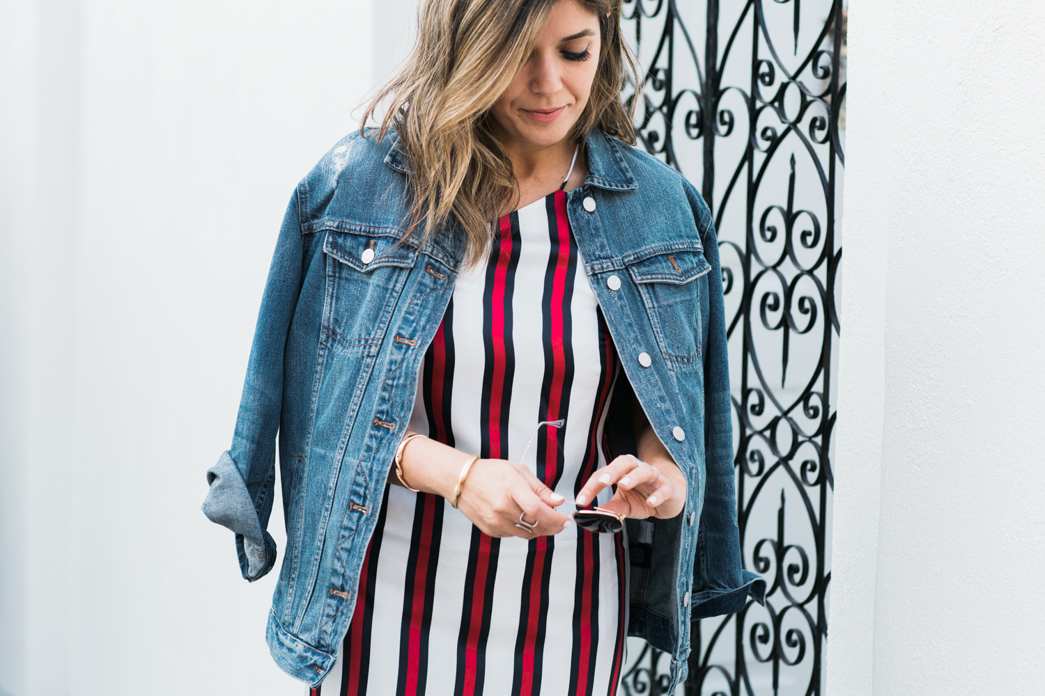 Sara Azani of Style MBA wearing Finders Keepers striped dress and Madewell Denim jacket