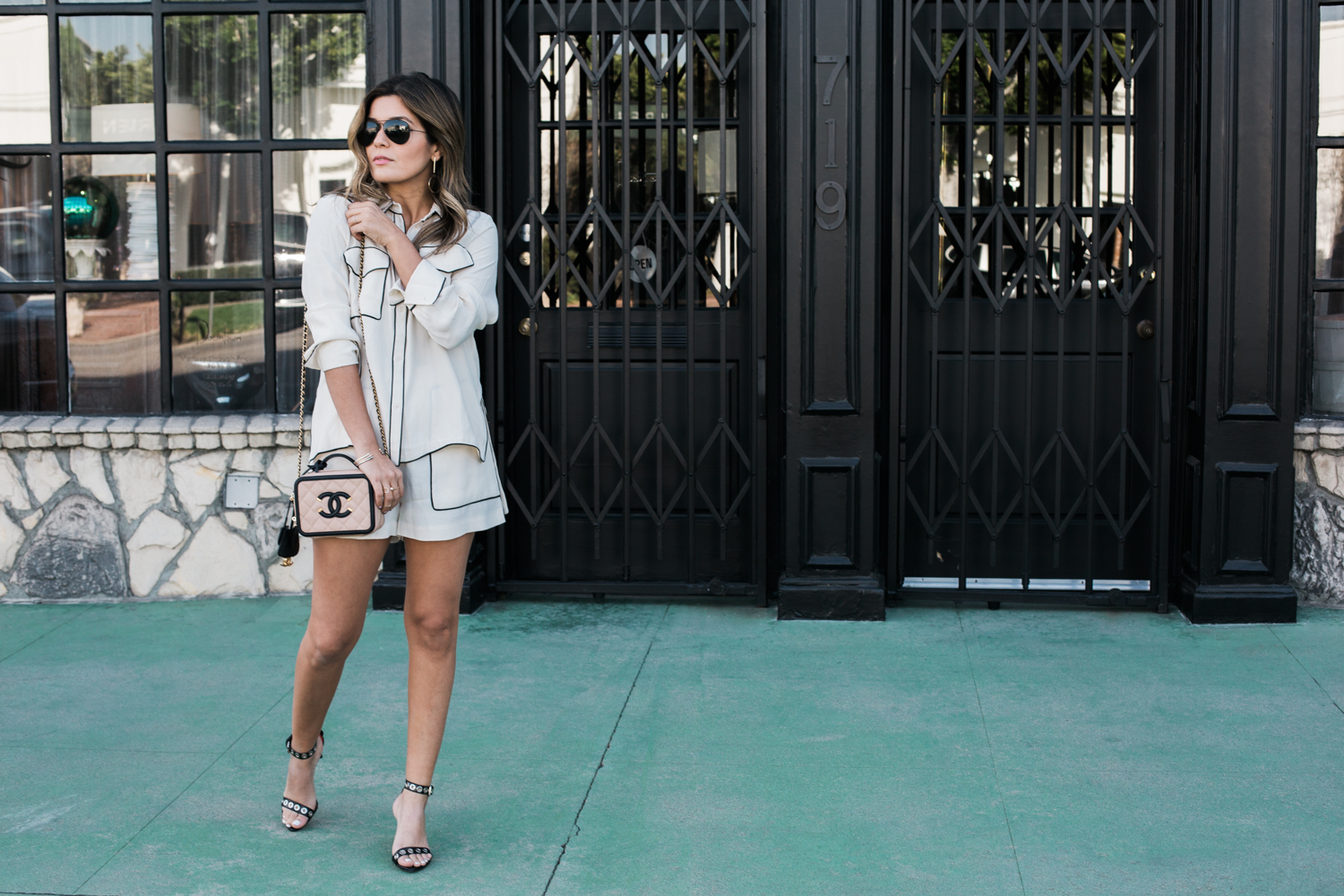 Style MBA Wears C/MEO shorts and top with Chanel Vanity Case