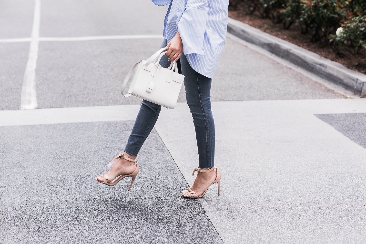 Style MBA wears nude heels and white bag