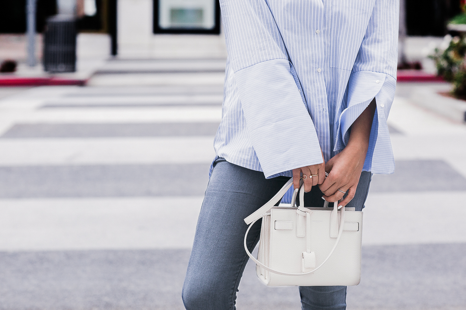 Style MBA wears oversized dress shirt and YSL bag