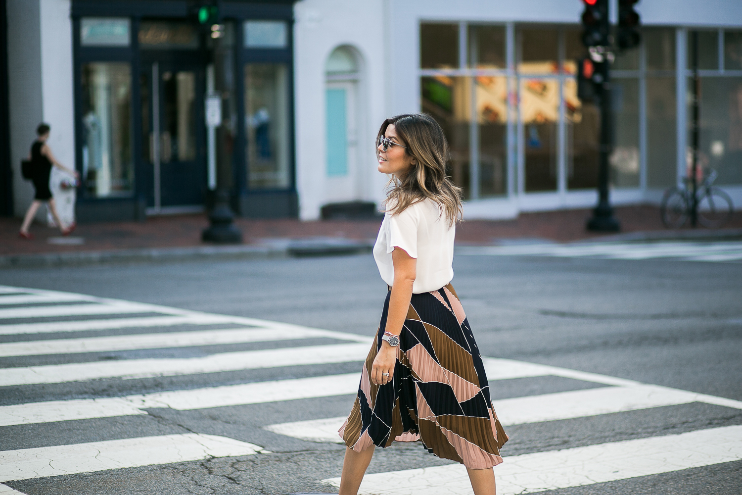 Style MBA wears pleated skirt