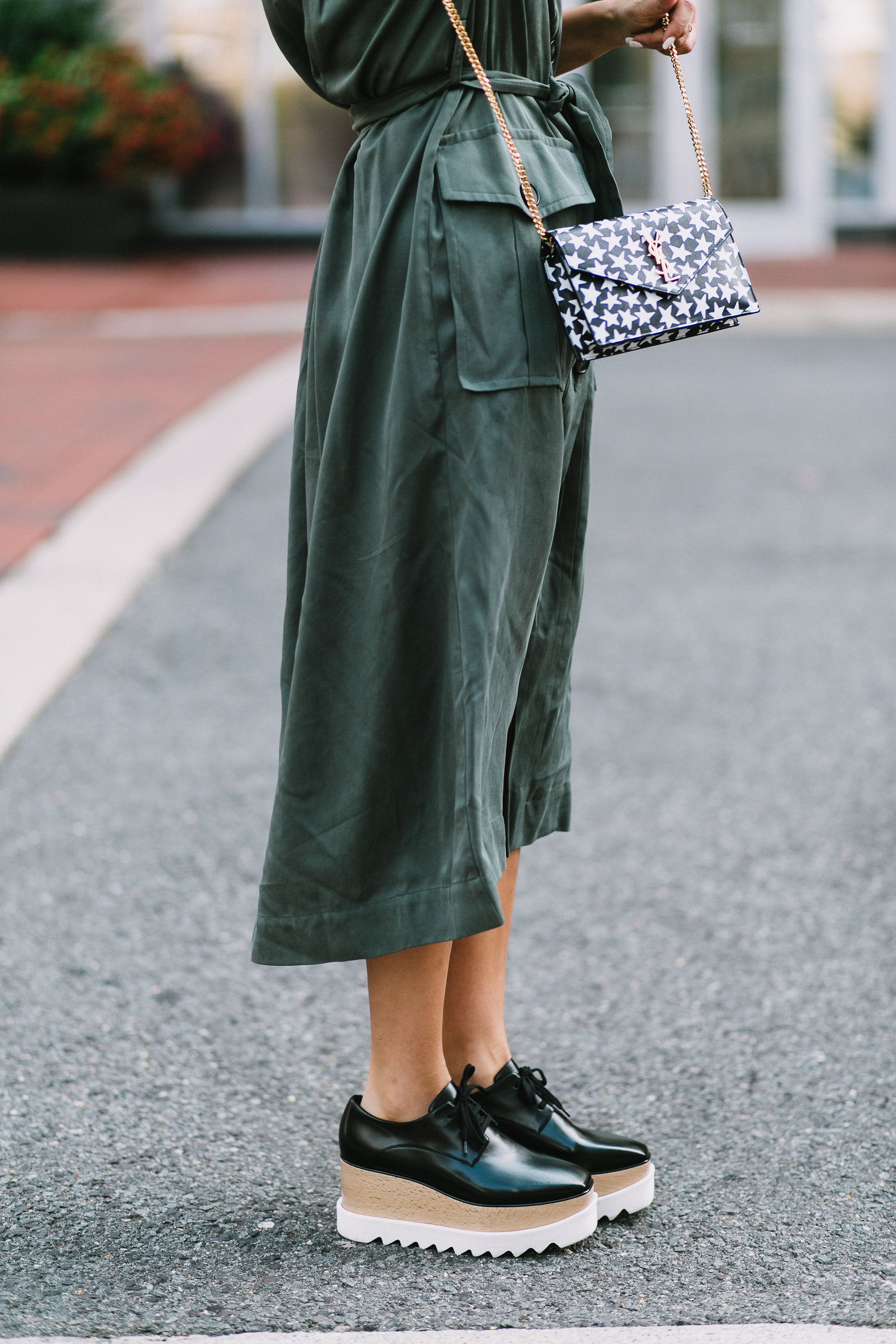 Style MBA wears Asos utility trench dress and YSL Star Bag