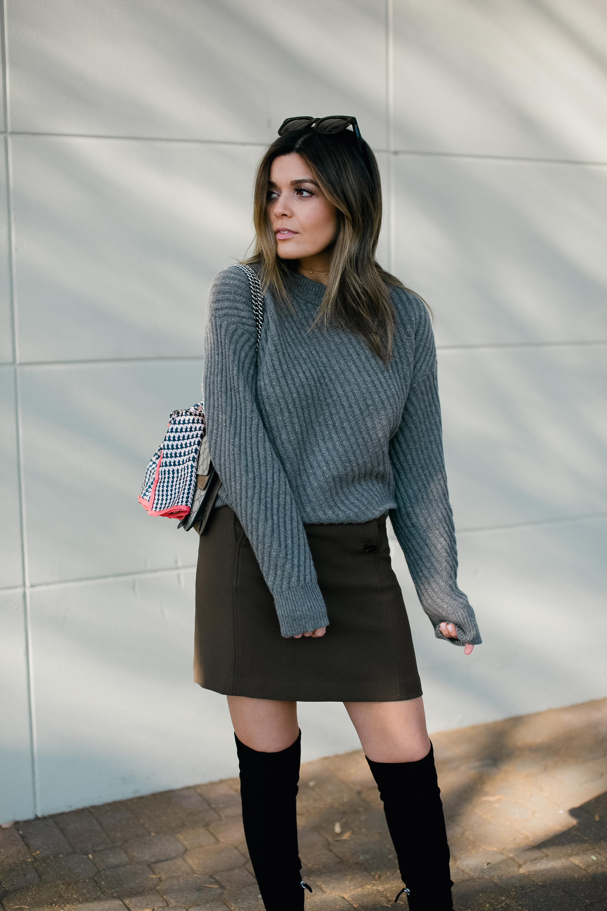 Blogger Sara Azani of Style MBA wears an Ann Taylor Stitched Cashmere Sweater, Ann Taylor Button Fron A-Line Skirt, Ann Taylor Anna Marie Heeled Suede Boots, and Ann Taylor boardwalk Sunglasses, and Ann Taylor houndstooth Silk Little Scarf from the Ann Taylor Silk Littles Collection.