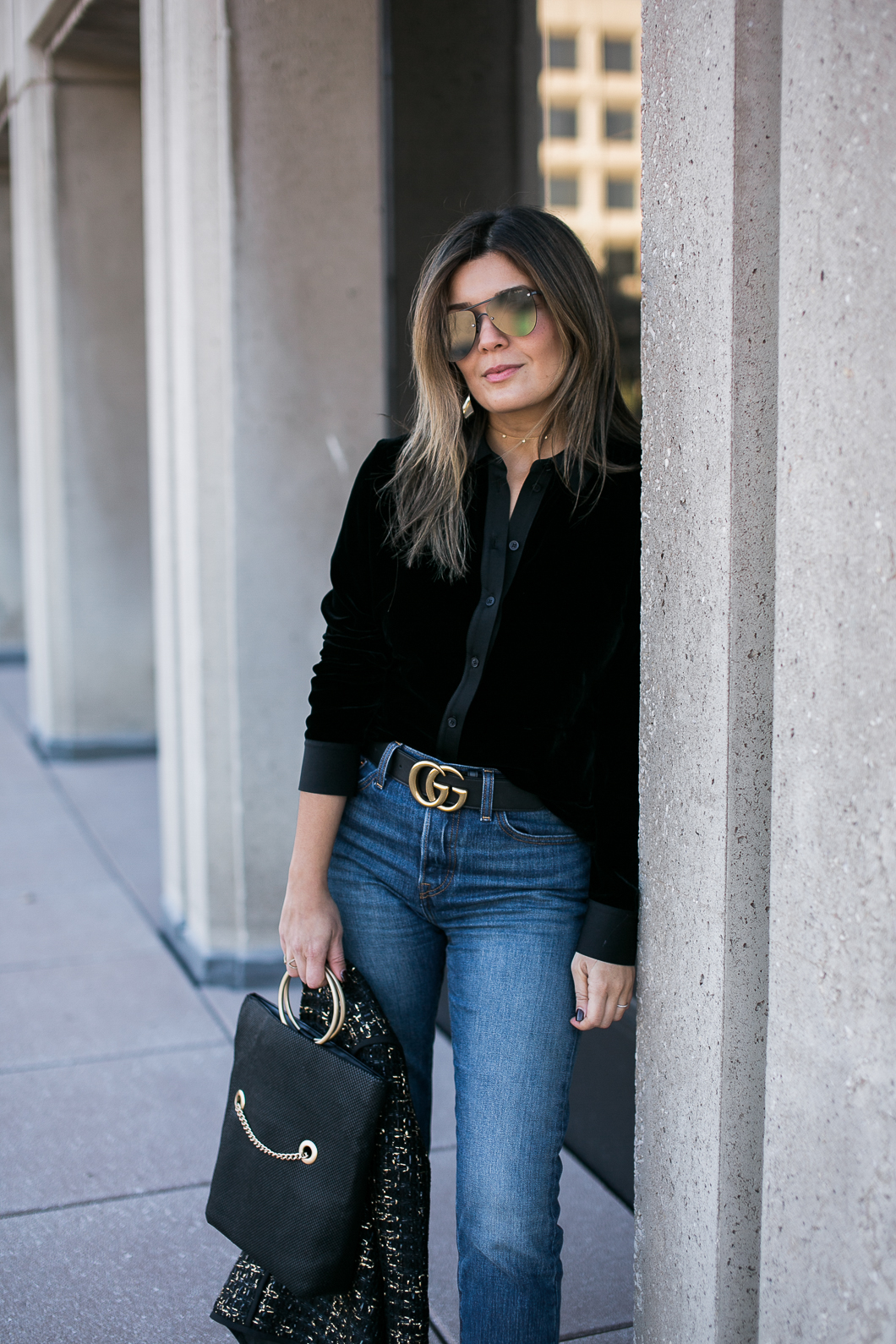 Blogger Sara Azani of Style MBA wearing a black Gucci leather belt with double G buckle, 5 Disc Choker Necklace, Whiting & Davis Fold-Over Tote, LEVI'S Wedgie Skinny Jean, Lafayette 148 New York tweed jacket, and Vince portia point toe pump as part of her black and gold look in front of a stone building in Washington, DC.