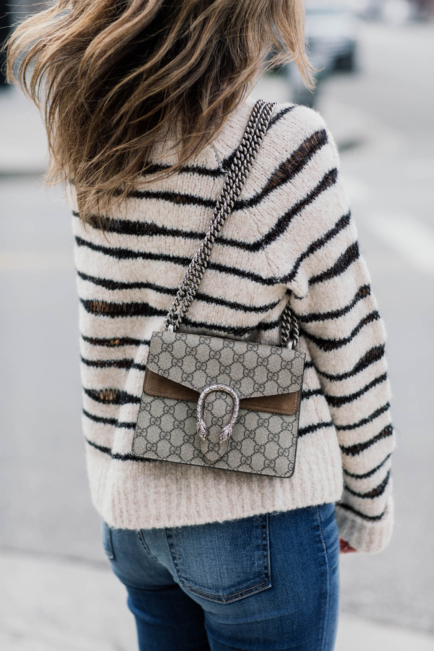 Blogger Sara Azani of Style MBA wearing Zadig and Voltaire white and black knit sweater, 7 For All Mankind crop skinny jeans, Steve Madden Stecy nude high-heeled sandal, Le Specs sunglasses, and a Gucci bag.