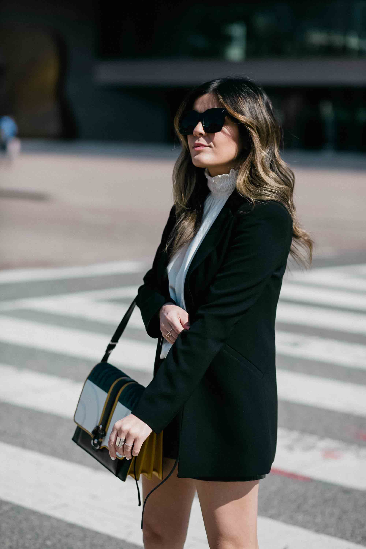 black-blazer-ruffle-top-leather-shorts